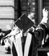 greyscale-photography-of-person-wearing-academic-dress