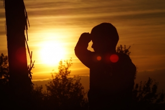 Picture of a child in front of a sunset