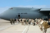 US Navy board a plane to deploy to the 5th fleet area of responsibility_in_support_of_the_global_war_on_terrorism